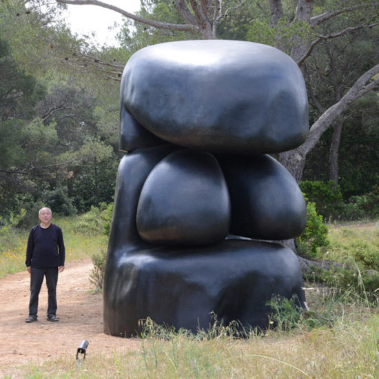 "Wang Keping with his sculpture ""Lolo"" collected by Fondation Carmignac 2018"